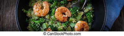 Vegan food - roasted garlic broccoli quinoa salad with...