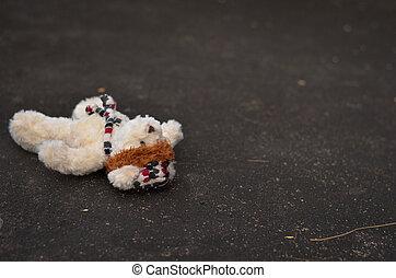 teddy bear lie down on the floor
