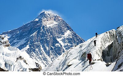 view of Everest from Gokyo valley with group of climbers on...