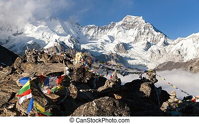 View from Gokyo Ri to mount Gyachung Kang 7952m with prayer...