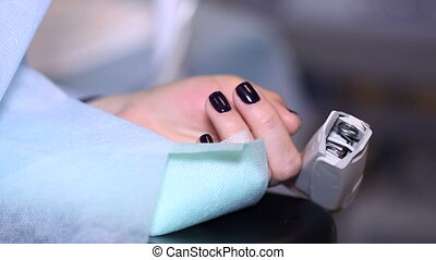 Female hand on the surgical table Training in operating the...