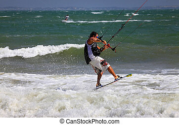 Kite surfer in action - Kite boarder enjoy surfing in ocean....