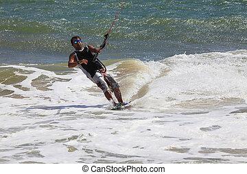 Kite surfer in action - Kite boarder enjoy surfing in ocean...