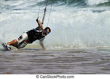 Kite surfer in action - Kite boarder enjoy surfing in ocean....