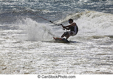 Kite surfer in action - Kite boarder enjoy surfing in ocean...