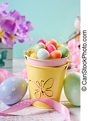 easter pastel colors decoration with candy eggs in small...
