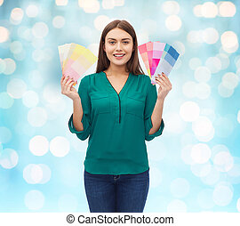 smiling young woman with color swatches - color scheme,...