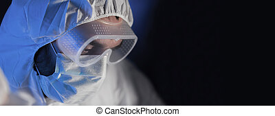 close up of scientist face in chemical lab - science,...