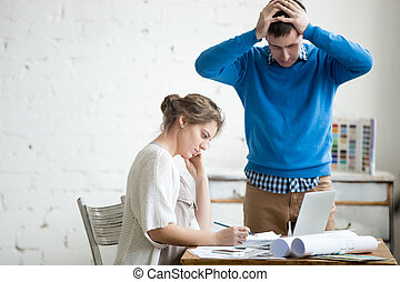 Two colleagues feeling troubled at work