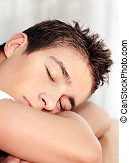 Young Man sleeping - Young Man Sleeping on the Table closeup