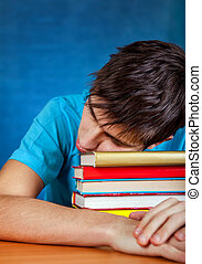 Young Man with the Books - Tired Young Man sleep on the...