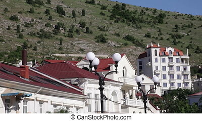 roofs on a background of mountains - roofs of houses on a...