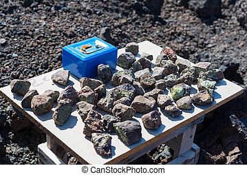 Selling lavastones with peridot olivine at Los Hervideros in...