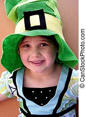 Girl in St Pattys day hat - Young girl wearing green st...