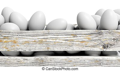 White eggs in old wooden container closeup, isolated on...