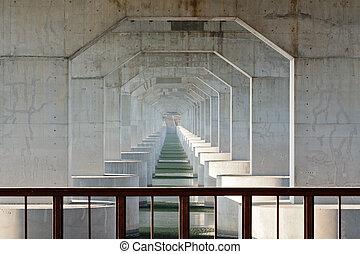 Under the highway bridge