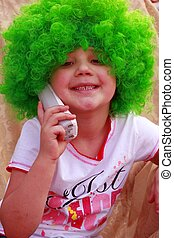 Little girl on St Pattys day wearing green wig and talking...