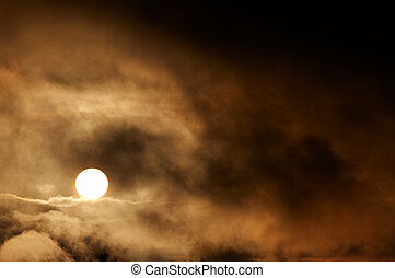 Dark storm clouds and setting sun - Abstract image of the...
