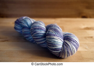Lilac variegated yarn on a hank
