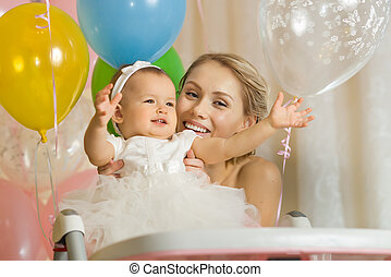 happy family - one-year-old little girl with mammy, happy...