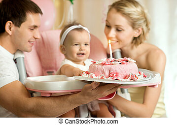 happy family - one-year-old little girl with daddy and mammy...