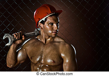 workman - closeup portrait the beauty muscular workman, in...