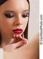 Creating beautiful makeup. - Makeup artist creating...