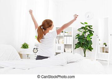 morning awakening of young woman in bed