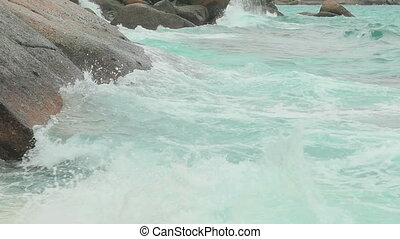 Turquoise rolling wave, slow motion