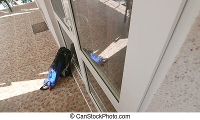 Man with backpack and snorkeling set unlocking entrance door...