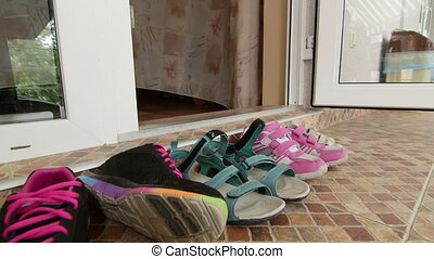 shoes for outdoor activities at the entrance to hotel room -...