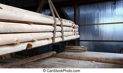 Wood industry Manipulator lifts logs for building - Wood...