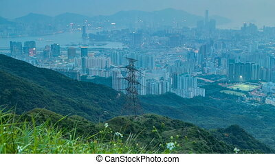 Day to night transition from Fei ngo shan Kowloon Peak night timelapse Hong Kong cityscape skyline.
