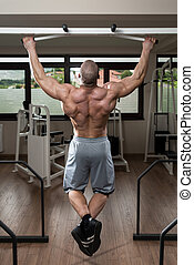 Gym Workout For Back - Young Male Bodybuilder Doing Heavy...