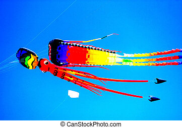 Bright colorful kites - Colorful kites flying in blue sky,...
