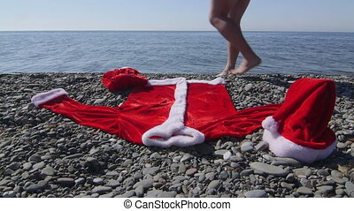 Man dressed as Santa Claus going to swim in the sea