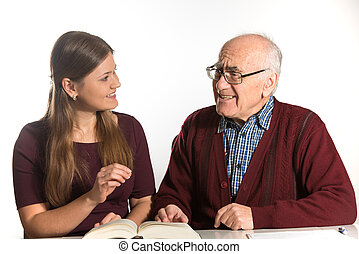 woman helps senior man - young woman helping senior man to...