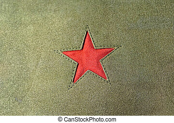 Red star symbol at green textile