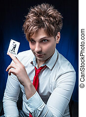 man with joker - man illusionist with joker card in hand