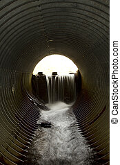 Water Pipe - Water flowing from a dam theough a large pipe