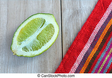 Flat lay of ripe lime cut in half