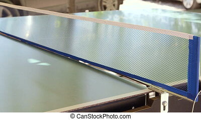 Close-up of outdoor table tennis game set net racket and  ping pong ball