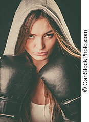 Woman wear hoodie and boxer gloves. - Exercising prepare for...