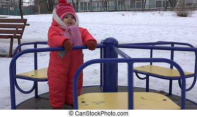 Sweet Newborn Baby Spinning on Carousel in a Winter Day -...