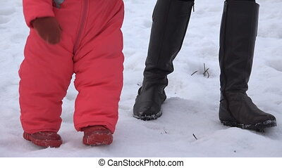 Newborn Baby Girl Walking She's First Steps in a Winter Day