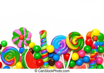 Bottom border of an assortment of colorful candies against a...