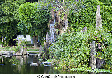 Chinese rockery in garden - Chinese rockery with bamboo and...