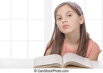 pre-teen girl reads a book - a pre-teen girl reads a book