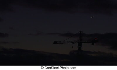 Timelapse Crane at sunrise - Timelapse of silhouette crane...