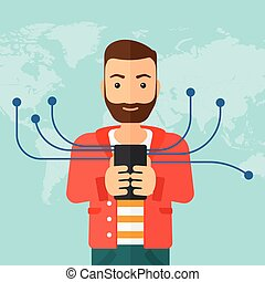 Man using smartphone - A hipster man with the beard holding...